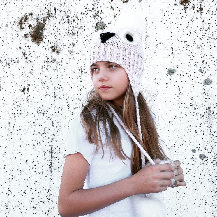 girl wearing white shirt and beanie