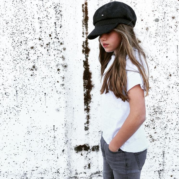 tween girl wearing I dig denim jeans and black hat