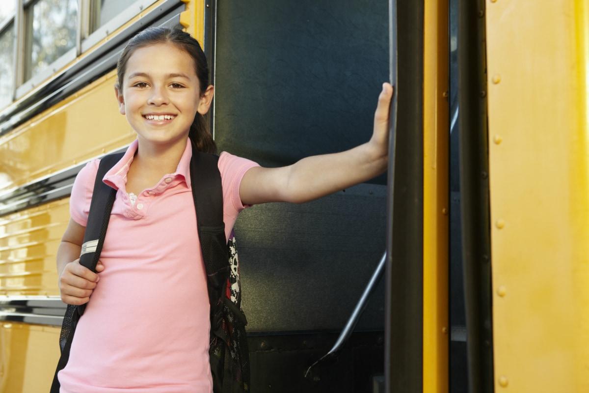 tween girl getting on bus
