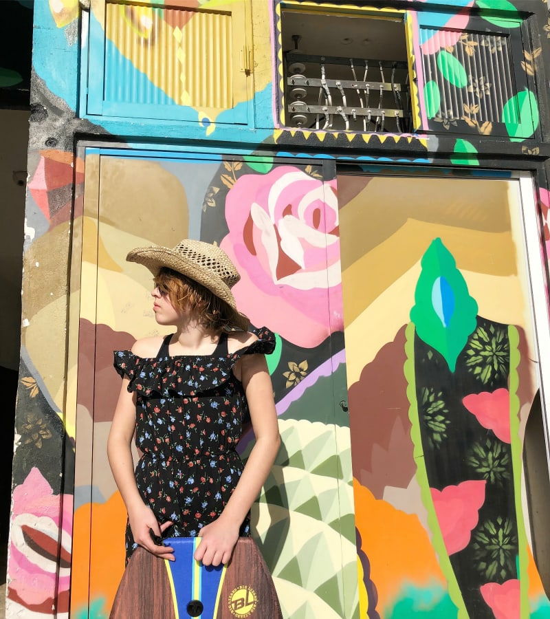 tween girl wearing hat