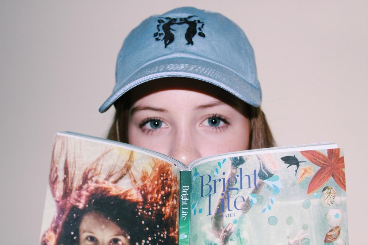 Tween Girl looking over Bright Lite Magazine