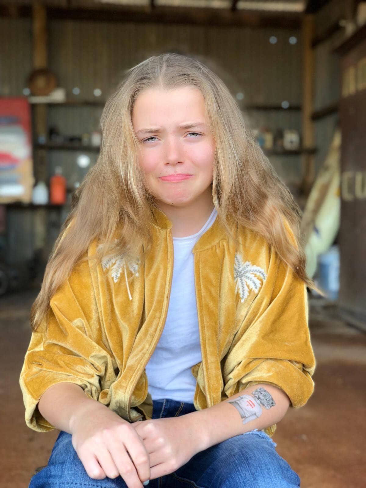 tween girl wearing yellow jumper