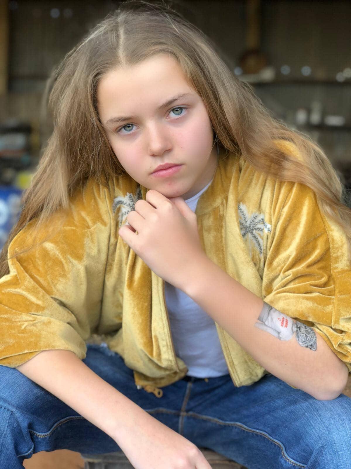 girl wearing yellow jacket, posing