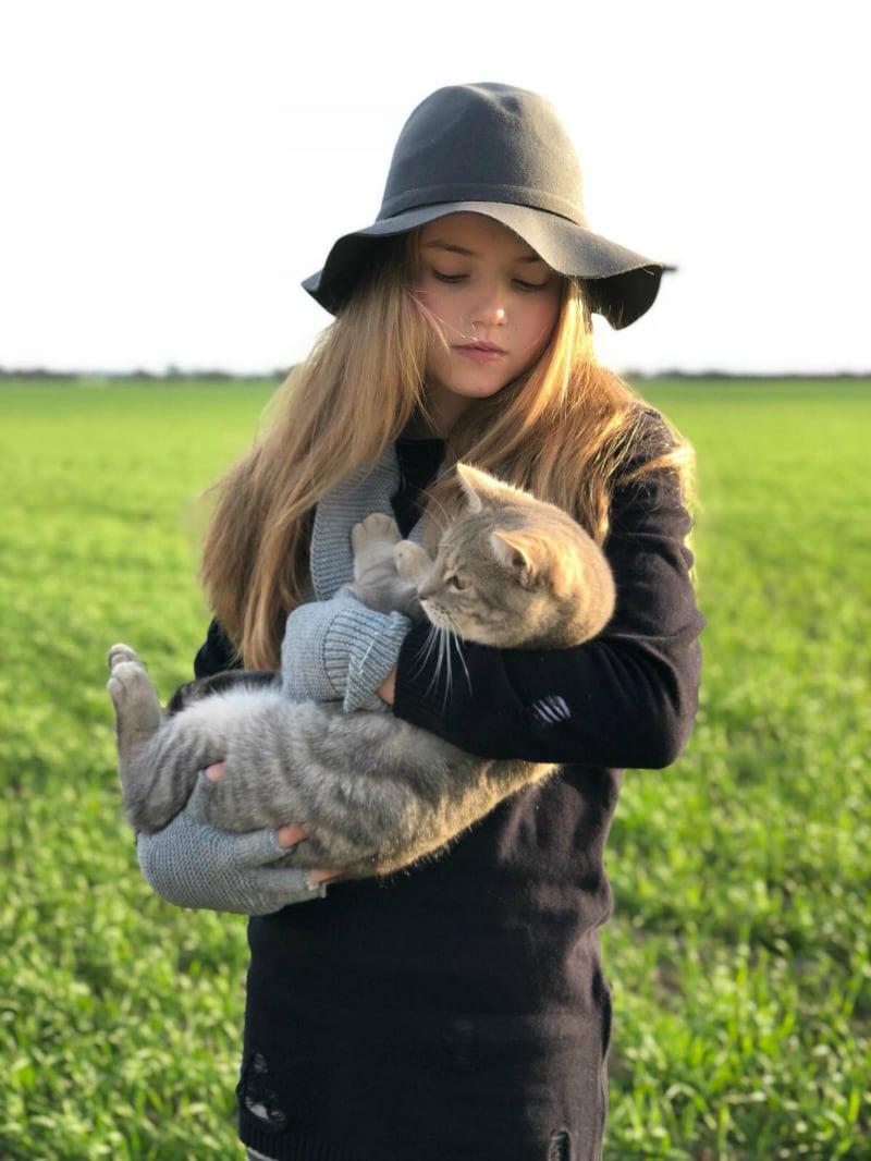 SUDO fashion shoot - girl holding cat