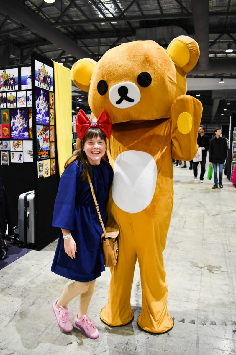 standing with a bear at comic con
