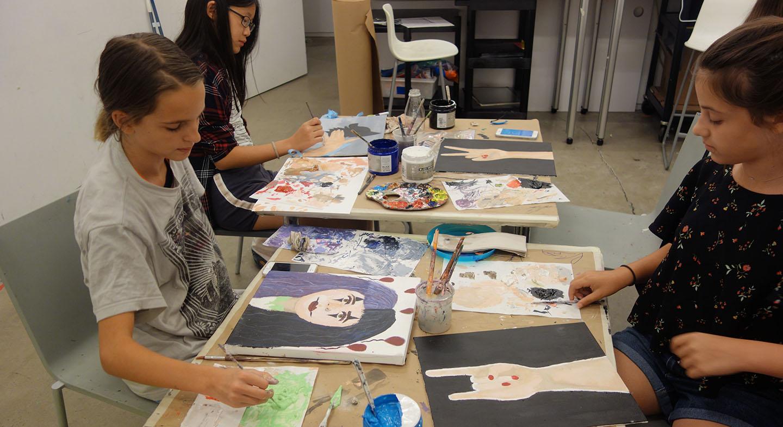 Tween girls working on artwork