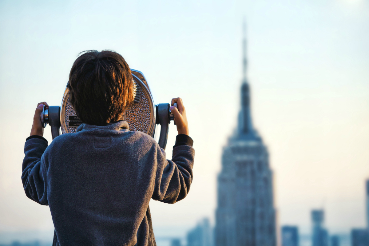 little boy looking at Empire State building
