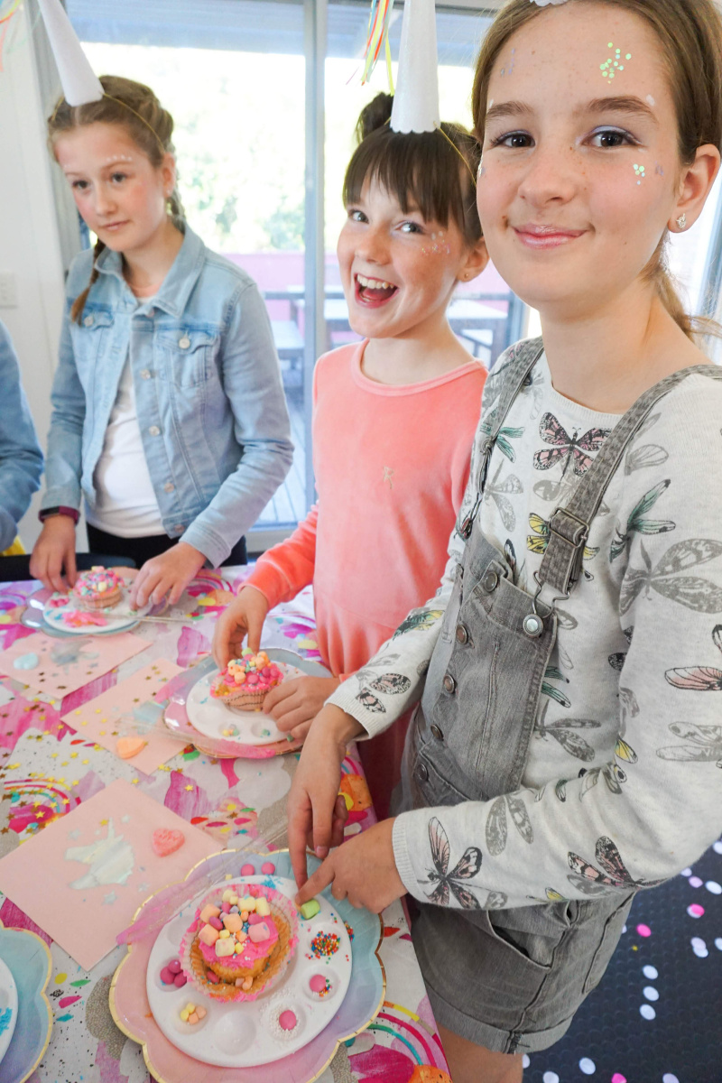Tween girls at unicorn themed party