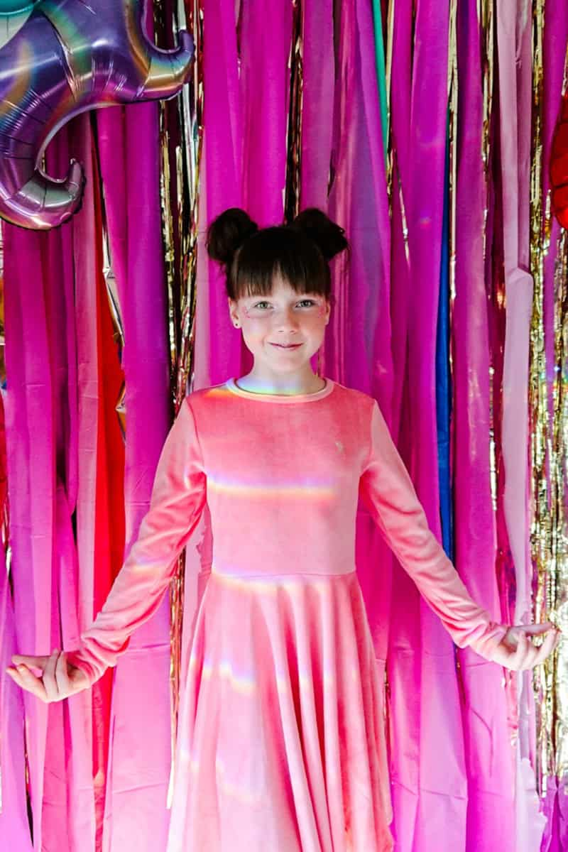 tween girl standing in pink dress