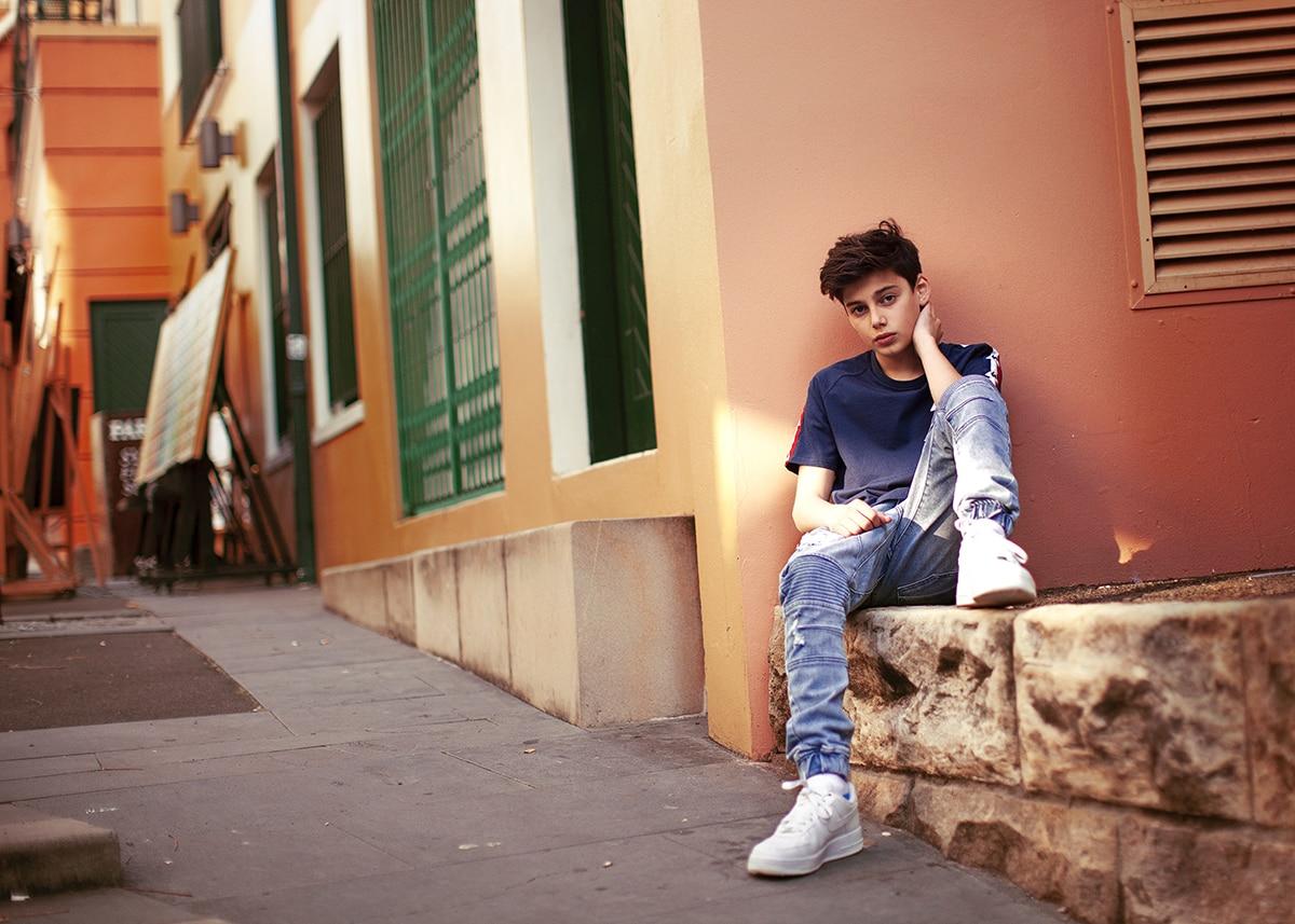 Tween boy posing for fashion photoshoot