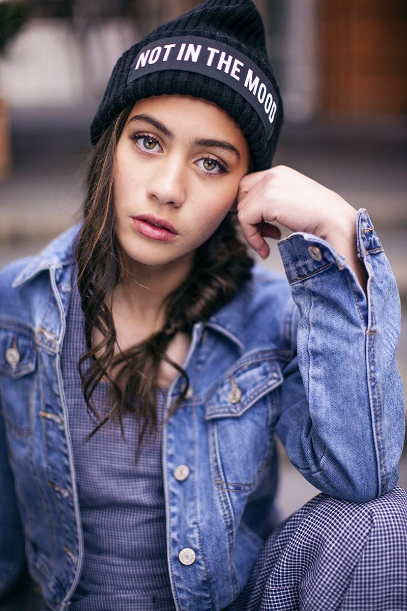 Girl wearing denim jacket