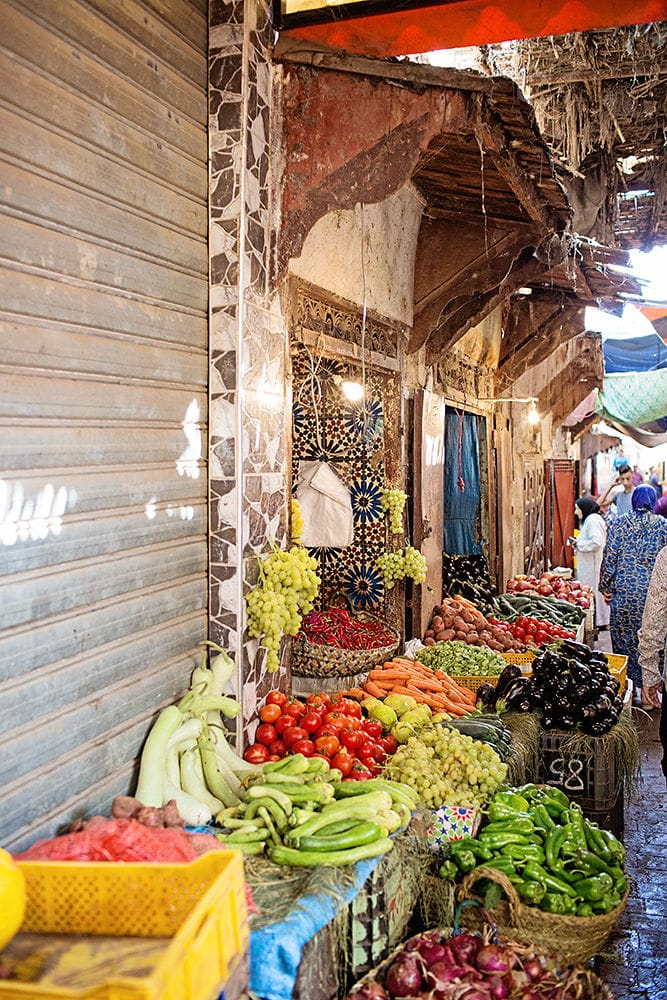 Worldschooling and walking through streets of Morocco. Looking at fruit and veggie markets