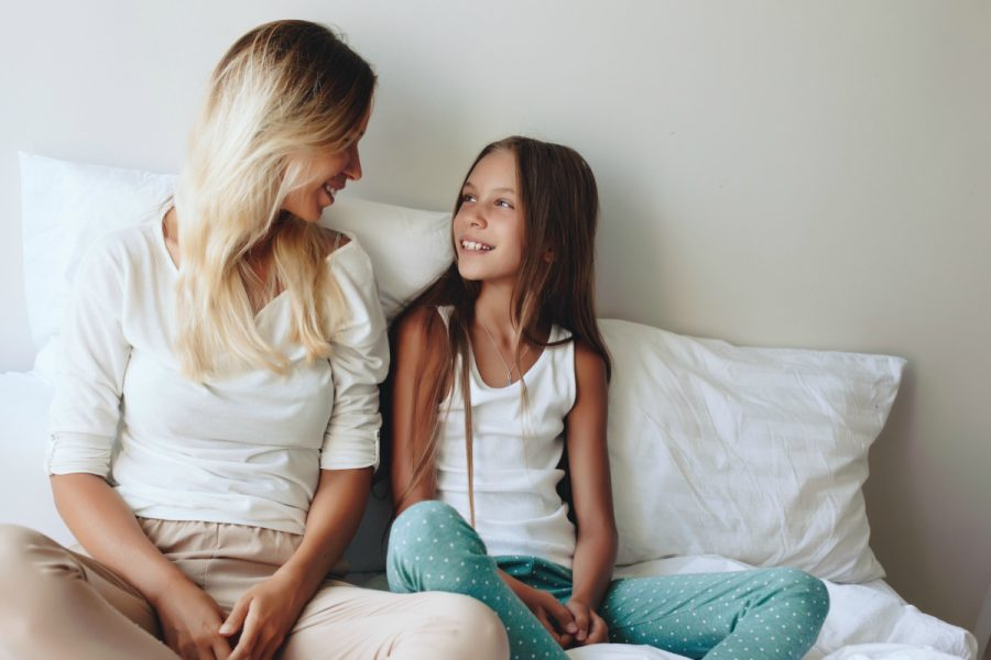 mum and daughter sitting together talking about positive body image
