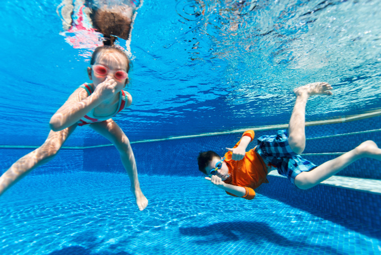 School holiday activities - kids swimming in the pool