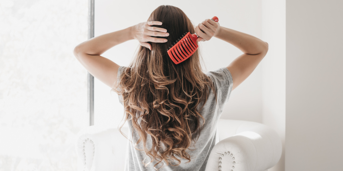 tween girl brushing her hair