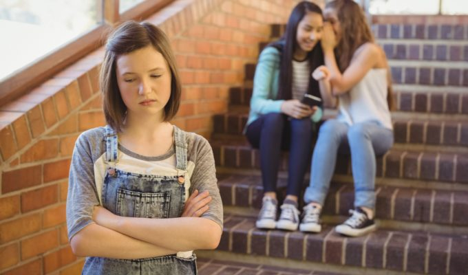 Teenage Bullying - Girl being talked about by other girls.