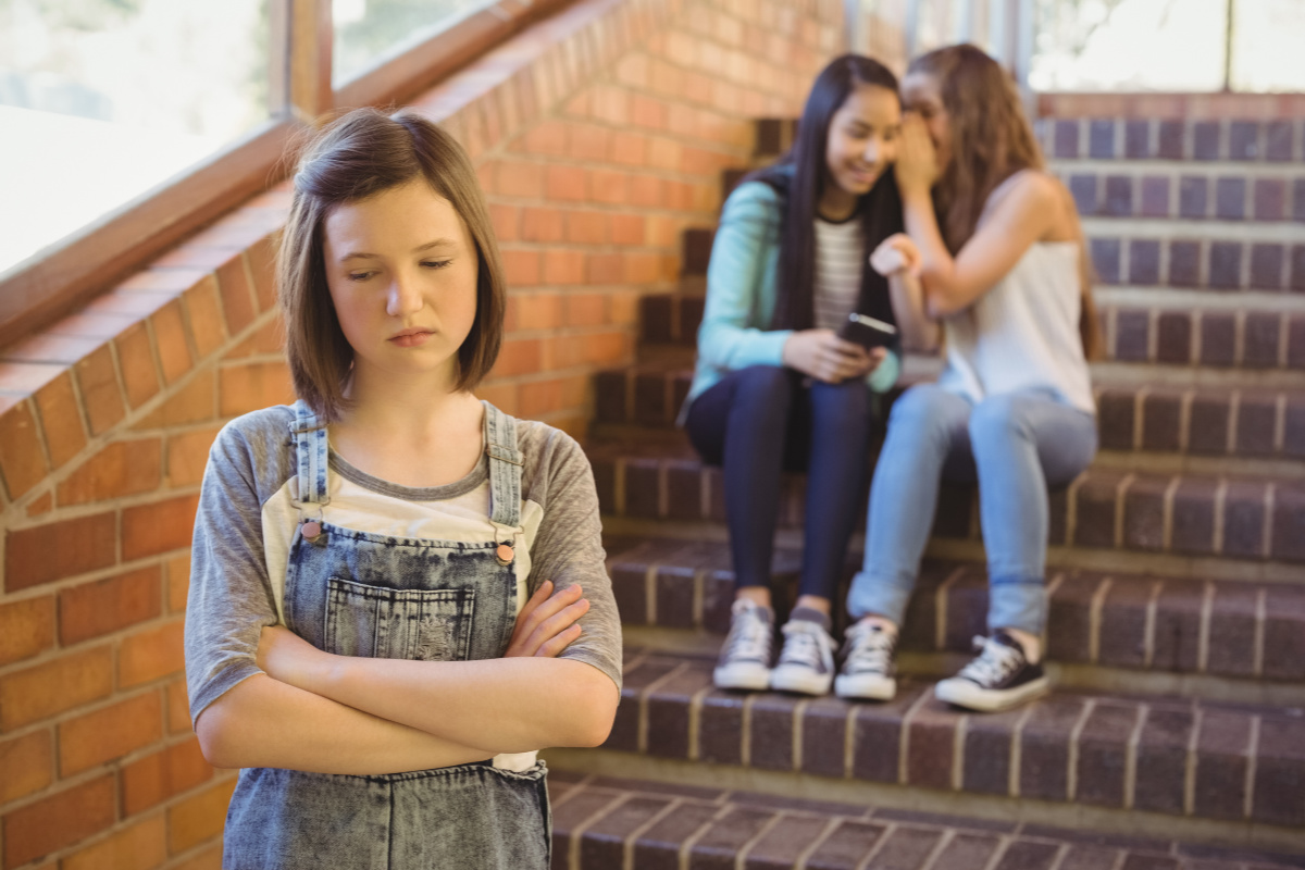 'My daughter is being bullied at school'. Girl being talked about/ bullied by friends.