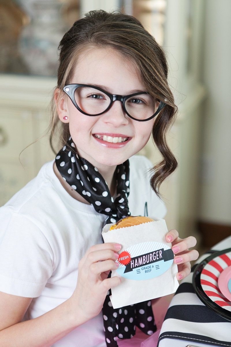 Tween Girl eating hamburger