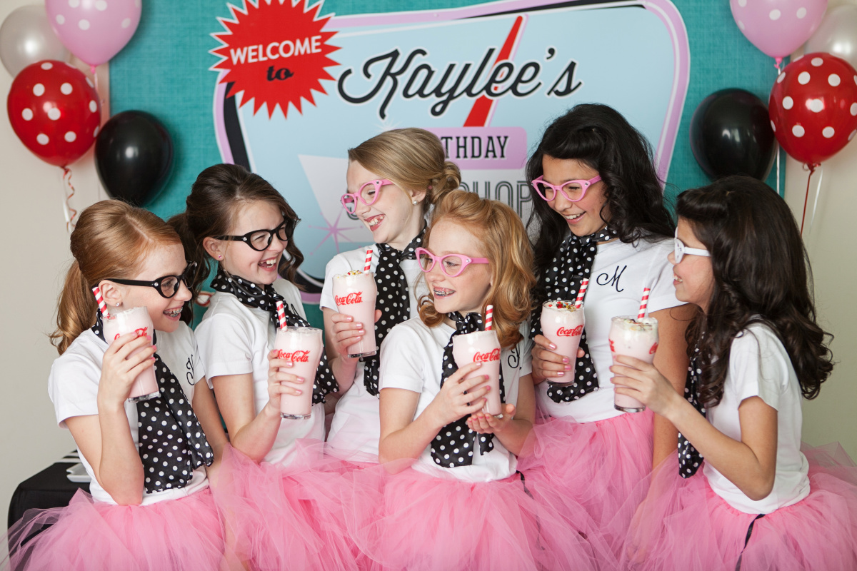 Girls having a milkshake at party
